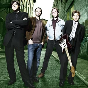 Bassist Bill Leen of the Gin Blossoms is the only band member naive enough to bring his instrument with him to a bad neighbourhood